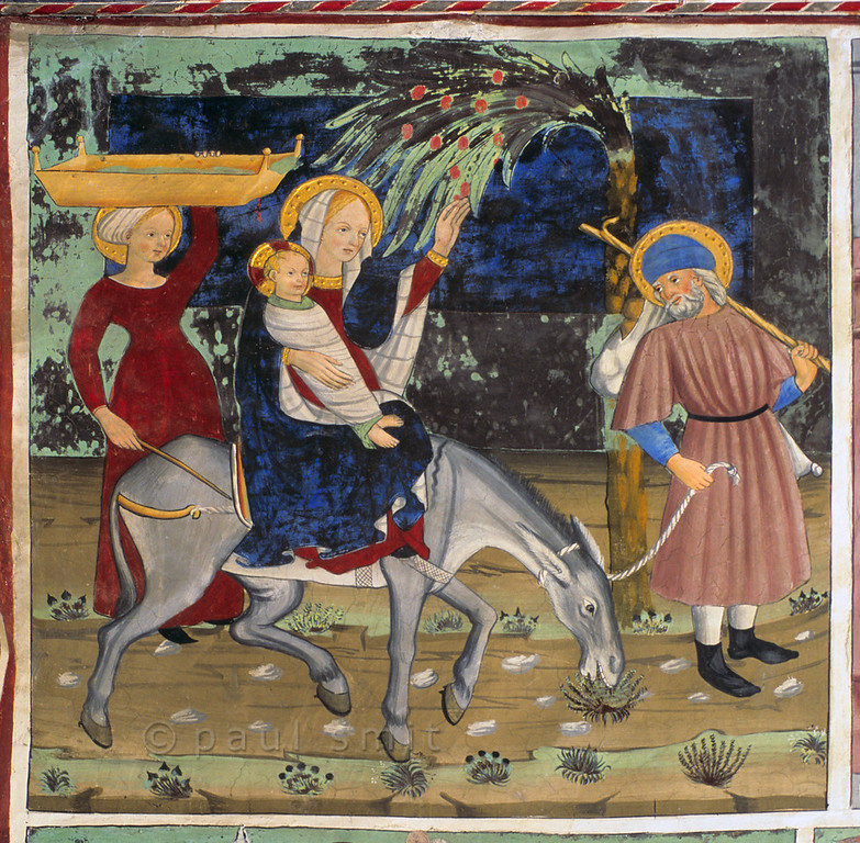 [FRANCE.ALPSNORTH 10971]<br /> 'Flight to Egypt.'<br /> <br /> Not only do the frescoes in the Chapelle Saint Sébastien in Lanslevillard reach an astonishing high artistic level, the colours have kept their original saturation as well. This most important work of art in the Haute Maurienne has been painted at the end of the 15th century by artists from Piemonte (now in Italy but then in the same country: Savoy). Its location may seem unexpected: a small village deep in the Alps. But the chapel is situated right at the start of the pass road over the Col du Mont Cenis, in those days one of the main connections between France and Italy.<br /> <br /> This fresco, showing the Flight to Egypt, adds some elements that are not part of the Bible story but come from the New Testament apocrypha: the miracle of the date palm bending down, so its fruit can be picked, and the presence of Salome as Jesus' nurse. Photo Paul Smit.