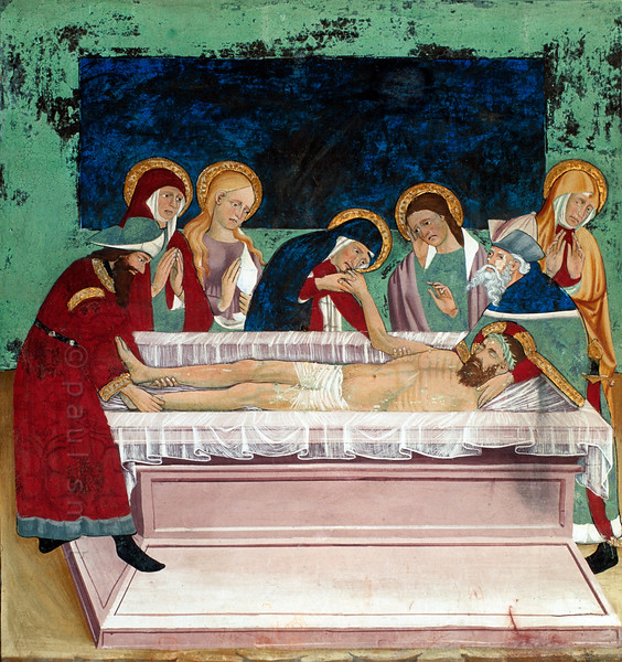 [FRANCE.ALPSNORTH 10976]<br /> 'Entombment of Jesus.'<br /> <br /> Not only do the frescoes in the Chapelle Saint Sébastien in Lanslevillard reach an astonishing high artistic level, the colours have kept their original saturation as well. This most important work of art in the Haute Maurienne has been painted at the end of the 15th century by artists from Piemonte (now in Italy but then in the same country: Savoy). Its location may seem unexpected: a small village deep in the Alps. But the chapel is situated right at the start of the pass road over the Col du Mont Cenis, in those days one of the main connections between France and Italy.<br /> <br /> In the fresco two men are present at the entombment of Christ: Joseph of Arimathea at left and Nicodemus at right. Probably it is Jesus' mother Mary who holds his hand. Mary Magdalene is the only woman with her hair completely uncovered. Photo Paul Smit.