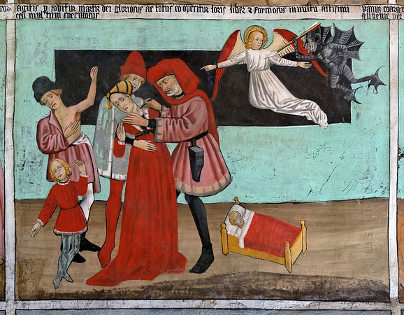 [FRANCE.ALPSNORTH 10969] 'Treating the Plague.'  Not only do the frescoes in the Chapelle Saint Sébastien in Lanslevillard reach an astonishing high artistic level, the colours have kept their original saturation as well. This most important work of art in the Haute Maurienne has been painted at the end of the 15th century by artists from Piemonte (now in Italy but then in the same country: Savoy). Its location may seem unexpected: a small village deep in the Alps. But the chapel is situated right at the start of the pass road over the Col du Mont Cenis, in those days one of the main connections between France and Italy.  In those days people prayed to St. Sebastian as protection against the plague. In fact it was a rich bourgeois, who, after staying healthy during an epidemic, paid for the fresco painters, as a way of saying thank you to the saint.  This fresco is one of a series showing the life of St. Sebastian. A doctor, helped by an assistant and the saint's spirit, is piercing a bubo of a woman. The plague was seen as a punishment by god, illustrated by the angel that is inviting a demon to find more sinners. So should we conclude St. Sebastian is working against the will of God? Photo Paul Smit.
