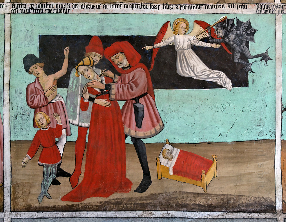 [FRANCE.ALPSNORTH 10969]<br /> 'Treating the Plague.'<br /> <br /> Not only do the frescoes in the Chapelle Saint Sébastien in Lanslevillard reach an astonishing high artistic level, the colours have kept their original saturation as well. This most important work of art in the Haute Maurienne has been painted at the end of the 15th century by artists from Piemonte (now in Italy but then in the same country: Savoy). Its location may seem unexpected: a small village deep in the Alps. But the chapel is situated right at the start of the pass road over the Col du Mont Cenis, in those days one of the main connections between France and Italy.<br /> <br /> In those days people prayed to St. Sebastian as protection against the plague. In fact it was a rich bourgeois, who, after staying healthy during an epidemic, paid for the fresco painters, as a way of saying thank you to the saint.<br /> <br /> This fresco is one of a series showing the life of St. Sebastian. A doctor, helped by an assistant and the saint's spirit, is piercing a bubo of a woman. The plague was seen as a punishment by god, illustrated by the angel that is inviting a demon to find more sinners. So should we conclude St. Sebastian is working against the will of God? Photo Paul Smit.