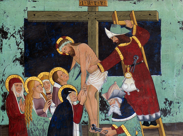 [FRANCE.ALPSNORTH 10975] 'Deposition of Jesus.'  Not only do the frescoes in the Chapelle Saint Sébastien in Lanslevillard reach an astonishing high artistic level, the colours have kept their original saturation as well. This most important work of art in the Haute Maurienne has been painted at the end of the 15th century by artists from Piemonte (now in Italy but then in the same country: Savoy). Its location may seem unexpected: a small village deep in the Alps. But the chapel is situated right at the start of the pass road over the Col du Mont Cenis, in those days one of the main connections between France and Italy.  In this fresco only women were present when Jesus was taken from the cross, among them his mother Mary (taking his hand) and Mary Magdalene (with long hair). In this interpretation of the scene it is Joseph of Arimathea and Nicodemus who remove the nails. Photo Paul Smit.