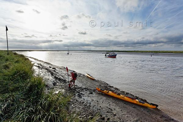 Kayaker at river mouth of Sèvre Niortaise.