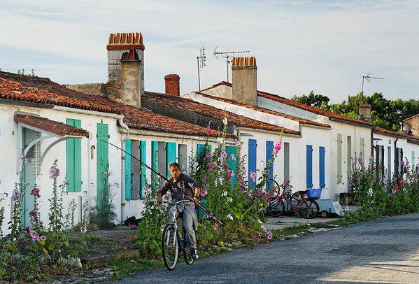 [FRANCE. ATLANTIC 30116] 'Cycling angler on Ile d'Aix.'