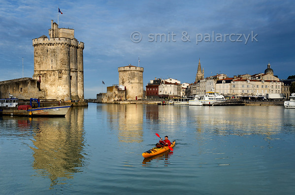 [FRANCE. ATLANTIC 30070] 'Kayaking in Old Harbour of La Rochelle.'