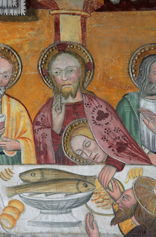 """[FRANCE.ALPSNORTH 10960] 'Jesus' girlfriend?'  We know that the person in Christ's embrace, in this Last Supper fresco in the Chapelle de Saint Antoine in Bessans, is St. John the Evangelist, also known as the Disciple whom Jezus Loved. But we have all read Dan Brown's """"Da Vinci Code"""" and he concluded that this person must be a woman: Mary Magdalene, his lover! The chapel and its frescoes date from the beginning of the 16th century. Photo Paul Smit."""