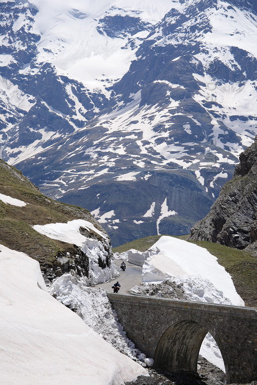 [FRANCE.ALPSNORTH 10933] 'Col de l'Iseran pass road.'  With 2770 m the Col de l'Iseran is the highest road pass of the Alps, connecting the Tarentaise in the north with the Maurienne in the south. Being a curvy and narrow road, having fabulous views over the snow covered giants of Vanoise and Gran Paradiso, it is a favorite with motorbikers. The Iseran Pass is one of 16 passes in the famous Route des Grandes Alpes. Photo Paul Smit.