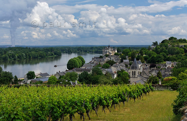 [FRANCE.LOIRE 10854] 'Village and castle of Montsoreau.'  	Surrounded by wine-hills the village and medieval castle of Montsoreau lie just downstream of the confluence of Loire and Vienne. The strange dark steam cloud rising up on the left of the picture is emitted by the nuclear power plant of Porte Boulet. Photo Paul Smit.