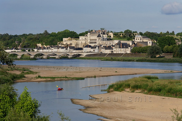 [FRANCE.LOIRE 10838] 'Amboise seen from secondary branch of Loire.'  	A kayaker navigates a secondary branch of the Loire, just downstream of Amboise. Photo Paul Smit.
