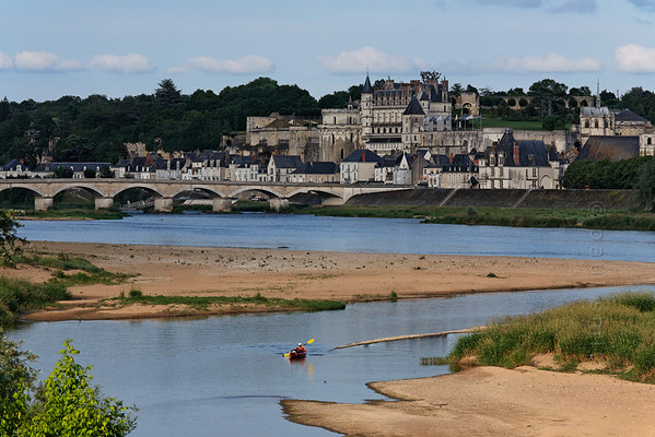 [FRANCE.LOIRE 10839] 'Amboise seen from secondary branch of Loire.'  	A kayaker navigates a secondary branch of the Loire, just downstream of Amboise. Photo Paul Smit.