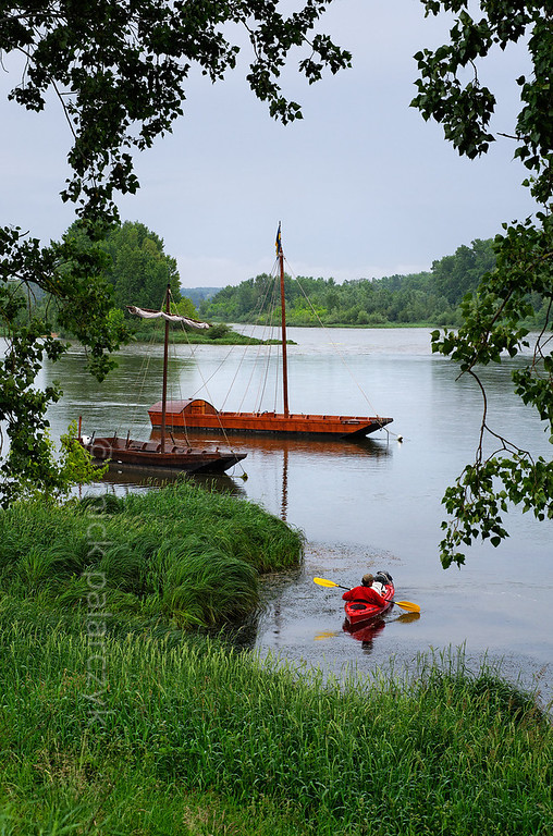 "[FRANCE.LOIRE 10789] 'Loire flatboats at Sigloy.'  	At Sigloy, four kilometers upstream of Chateauneuf-sur-Loire, kayakers can marvel at the reconstructed traditional flatboats ('chalands') of ""Les passeurs de Loire"", an organization that offers trips on the Loire. Photo Mick Palarczyk."