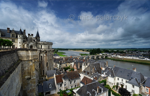 [FRANCE.LOIRE 10832] 'Loire seen from Amboise Castle.'  Amboise and the Loire seen from the terraced garden of the castle. The big tower (with romanesque windows) protruding from the castle is the 'Tour des Minimes' (or 'Cavalière). It houses a wide spiraling ramp which enabled horsemen and horse-drawn vehicles to ascend to the castle from the town below. Photo Mick Palarczyk.