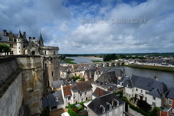[FRANCE.LOIRE 10833] 'Loire seen from Amboise Castle.'  Amboise and the Loire seen from the terraced garden of the castle. The big tower (with romanesque windows) protruding from the castle is the 'Tour des Minimes' (or 'Cavalière). It houses a wide spiraling ramp which enabled horsemen and horse-drawn vehicles to ascend to the castle from the town below. Photo Mick Palarczyk.