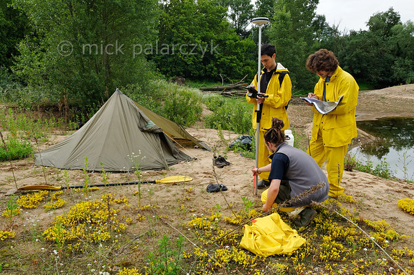 [FRANCE.LOIRE 10850] 'Geomorphology students on Loire bank.'  	Although the islands and wild banks of the Loire provide ample quiet locations for camping wild, sometimes there are unexpected visitors. Such as here, downstream of Bréhémont, where geomorphology students from the University of Tours monitor the shifting sands of the Loire banks with GPS equipment. Photo Mick Palarczyk.