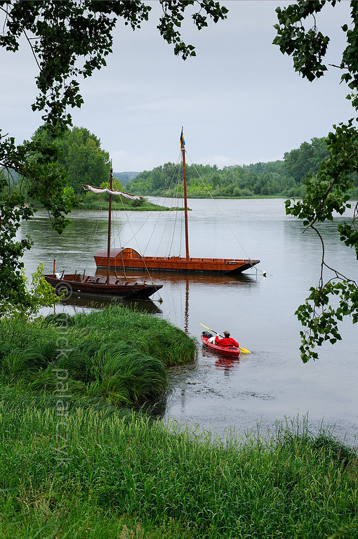 "[FRANCE.LOIRE 10790] 'Loire flatboats at Sigloy.'  	At Sigloy, four kilometers upstream of Chateauneuf-sur-Loire, kayakers can marvel at the reconstructed traditional flatboats ('chalands') of ""Les passeurs de Loire"", an organization that offers trips on the Loire. Photo Mick Palarczyk."