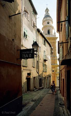 [FRANCE.COTEDAZUR 2631]  'Old town of Menton.'  The influence of Liguria in Italy reverberates in everything, symbolised by the baroque church towering over the old town centre. But as the fresh 'baguettes' show Menton is part of France. Photo Paul Smit.