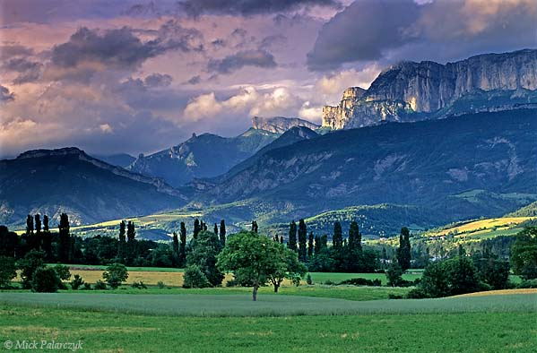 [FRANCE.ALPSSOUTH 24.411] 'Evening in the Drôme valley.'  When clouds play along the southern rim of the Vercors massif and the last sun rays of the day illuminate the higher fields, the Drôme valley south of Die becomes a magical place. Photo Mick Palarczyk.
