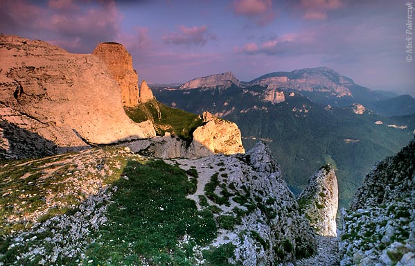 [FRANCE.ALPSNORTH 24.499] 'Edge of Vercors massif.'  	At the southern edge of the Vercors massif, limestone cliffs catch the last rays of the setting sun near the Pas de l'Echelette, just east of the Col de Rousset. Photo Mick Palarczyk.