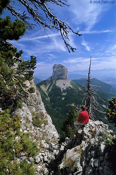 [FRANCE.ALPSNORTH 24.492] 'Mont Aiguille-3.'  Millennia of erosion have isolated the needle of the Mont Aiguille from the main limestone massif of the Hauts Plateaux du Vercors. Here a view from the Rochers du Parquet, at the eastern edge of the plateau. Photo Mick Palarczyk.