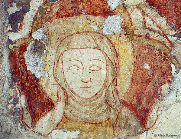 [FRANCE.RHONE 24.601 'Sketchy portrait.'  A simple but elegantly executed portrait of a medieval female saint has just withstood the ravages of time on a wall in the Gothic abbey church of St. Antoine-l'Abbaye. Photo Mick Palarczyk.