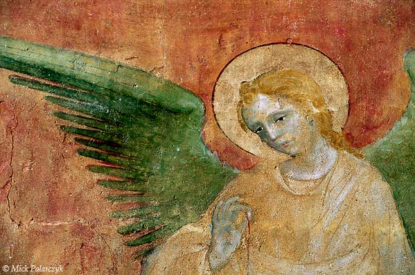 [FRANCE.RHONE 24.598 'Green winged angel.'  The green wing of an angel forms a striking contrast with a red background in a 15th century mural attributed to Robin Fournier. The picture can be found in the second northern chapel of the abbey church of St. Antoine-l'Abbaye and is part of a crucifixion scene. Photo Mick Palarczyk.