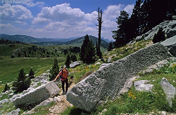 [FRANCE.ALPSNORTH 24.503] 'Roman quarry.'  At the Roman limestone quarry on the Hauts Plateaux du Vercors some fragments of ancient pillars can still be found. The quarry was in use from 125 to 275 AD and is situated along the Roman road that, crossing the Vercors massif, linked Die with Grenoble. Photo Mick Palarczyk.