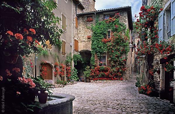 [FRANCE.ALPSSOUTH 24.368] 'Red square.'  Geraniums and roses have turned a square in the village of Châtillon-en-Diois into an orgy of red. Photo Mick Palarczyk.