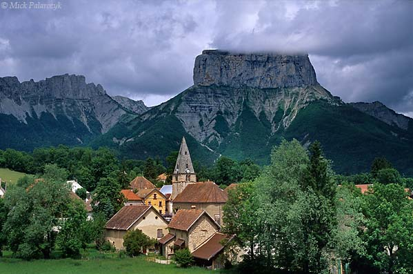 [FRANCE.ALPSNORTH 24.536] 'Chichilianne.'  At the eastern edge of the Vercors massif the isolated column of the Mont Aiguille towers above the Donnière valley and the village of Chichilianne. Photo Mick Palarczyk.