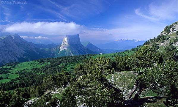 [FRANCE.ALPSNORTH 24.486] 'Mont Aiguille-1.'  Millennia of erosion have isolated the needle of the Mont Aiguille from the main limestone massif of the Hauts Plateaux du Vercors. Photo Mick Palarczyk.