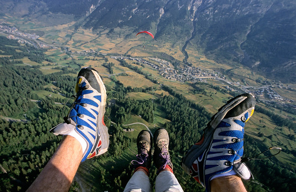 [FRANCE.ALPSNORTH 10968] 'Like an eagle.'  Would you like to enjoy the Haute Maurienne from another perspective? Then try a tandem paragliding flight. Claire and Zébulon, famous for their flight from the Mount Everest, can take you as a passenger, high above Lanslevillard. Photo Paul Smit.
