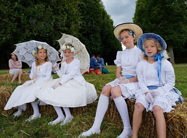 "[FRANCE.ILEDEFRANCE 11051] 'Girls at the White Picnic of Versailles.'  On Bastille Day, the 14th of July, a wonderful ""Déjeuner sur l'Herbe"" is organized in the gardens of the Palace of Versailles. Thousands of people come together with their picnic baskets and have a festive meal on the banks of the Grand Canal. In English it is known as the Picnic of Versailles or the White Picnic (""pique-nique en blanc""), since white is the dress code. Many people enjoy to dress up for the occasion (costumes by Sophie Morel from Dauphin-Dauphine). Photo Paul Smit."