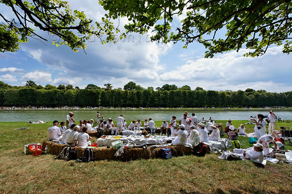 "[FRANCE.ILEDEFRANCE 11041] 'White Picnic of Versailles.'  On Bastille Day, the 14th of July, a wonderful ""Déjeuner sur l'Herbe"" is organized in the gardens of the Palace of Versailles. Thousands of people come together with their picnic bags and have a festive meal on the banks of the Grand Canal. In English it is known as the Picnic of Versailles or the White Picnic (""pique-nique en blanc""), since white is the dress code. Photo Paul Smit."