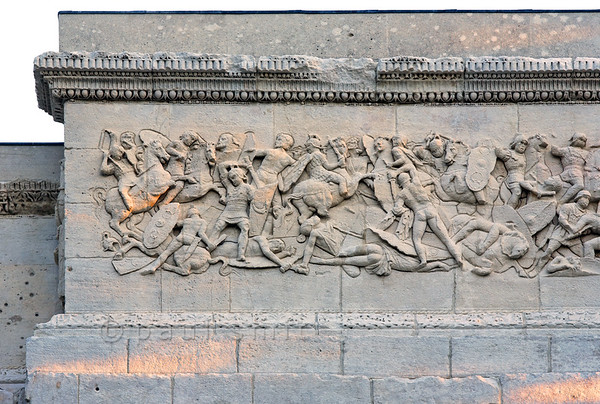 [FRANCE.PROVENCE 10907] 'Defeat of the Gauls.'  The relief on the northern facade of the Roman triumphal arch in Orange shows a battle between the Gauls and the Second Augustan Legion. The two fighting parties are easy to recognize. The 'barbarians' are depicted naked and mostly on foot, while the victorious Roman legionaries are the only ones on horseback and are shown in full battle dress. Roman Orange was founded in 35 BC by the veterans of this legion and the arch celebrates their victories. Photo Paul Smit.