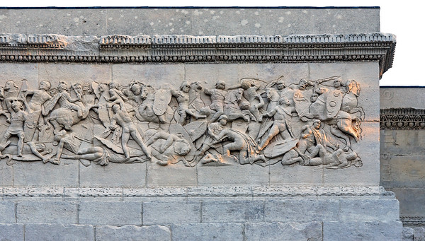 [FRANCE.PROVENCE 10906] 'Defeat of the Gauls.'  The relief on the northern facade of the Roman triumphal arch in Orange shows a battle between the Gauls and the Second Augustan Legion. The two fighting parties are easy to recognize. The 'barbarians' are depicted naked and mostly on foot, while the victorious Roman legionaries are the only ones on horseback and are shown in full battle dress. Roman Orange was founded in 35 BC by the veterans of this legion and the arch celebrates their victories. Photo Paul Smit.