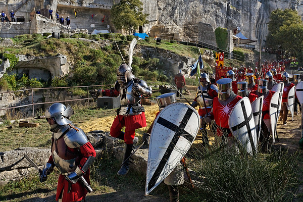 [FRANCE.PROVENCE 10676] 'Belligerent ancestors of the House of Orange.'  During a medieval reenactment in Les Baux-de-Provence, 50 km south of Orange, the army of Raymond V, Prince of Orange, advances to recapture his castle from Robert de Duras who had taken it while the Prince was absent. The noble Des Baux family became Counts of Orange in 1173 and then Princes of Orange from 1181 on. Photo Paul Smit.