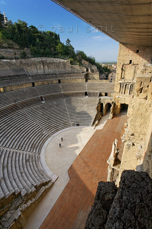 [FRANCE.PROVENCE 10891] 'Roman theatre in Orange.'  The 37 m high back wall (sceanea frons) of the Roman theatre in the town of Orange was refitted with a roof in 2006, after having been roofless for 1600 years. Unlike the original wooden roof the modern one is constructed of steel, glass and textile, which is a lot stronger. In this way the roof not only protects the ancient heritage but can also be used for suspending theatre lighting. To achieve good acoustics a layer of sound absorbing textile has been placed beneath the glass panes of the roof. The theatre was built between A.D 10 and 25 (during the rule of Emperor Augustus) and is on the World Heritage List of the UNESCO. Photo Paul Smit.