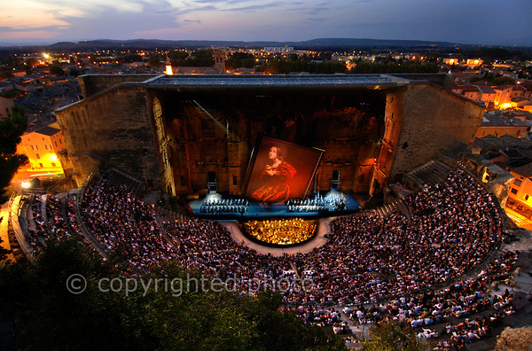 [FRANCE.PROVENCE 10897] 'Opera in the Roman theatre of Orange.'  Annual event highlights in the Roman theatre of Orange are Les Chorégies d'Orange, staging massive lyrical spectacles, such as Puccini's opera Tosca in this picture. It's no problem attracting the best performers, set designers and lighting artists as it is a great honour to perform in the Mother of all Theatres. A real treat for the ear and the eye. Please mention: Photo Philippe Gromelle/Grand Angle/Orange.