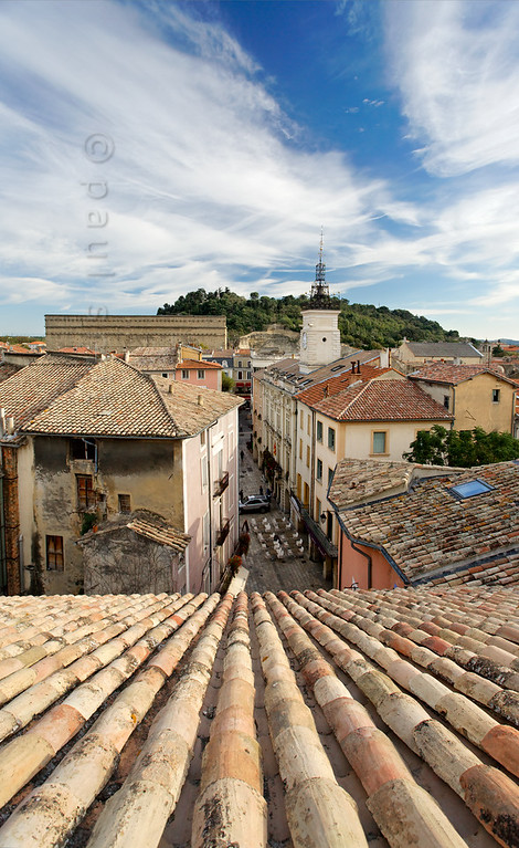 [FRANCE.PROVENCE 10877] 'Between cathedral and theatre.'  Orange is a small town with only 30.000 inhabitants. The old centre lies wedged between the enormous back wall of the Roman theatre and the cathedral, the roof of which provides the viewpoint for this picture. Between AD 1622 and 1673 the now wooded Hill of St.Eutrope, visible in the background, was crowned by one of the largest castles of Europe. It was built by the Dutch stadtholder Maurits, Prince of Orange, to defend the town and the freedom of religion it offered to French Protestants (Huguenots) who flocked to the town. Photo Paul Smit.
