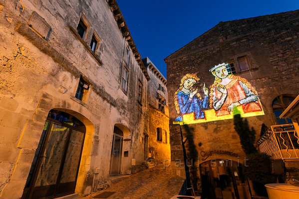 [FRANCE.PROVENCE 10745] 'Projections of old manuscripts in Les Baux-de-Provence.'  During the summer months the medieval village of Les Baux-de-Provence organizes several activities related to the Middle Ages. So, for instance, for a week the picturesque streets are enlivened with high-tech projections of medieval images. Les-Baux was once the seat of the noble Des Baux family who were Princes of Orange from 1181 till 1386. Photo Paul Smit.