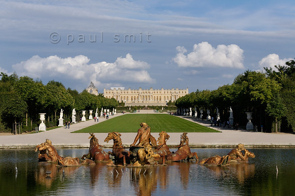 [FRANCE.ILEDEFRANCE 11103] 'Apollo Fountain and Palace of Versailles.'  The Palace of Versailles without working fountains is like a nightingale without voice. This picture shows the Apollo Fountain (Bassin d'Apollon). It was constructed between 1668 and 1670 by Tuby, after a drawing by Le Brun, and installed and gilded a year later. It depicts the sun god driving his chariot to light the sky. The fountain forms a focal point and serves as a transitional element between the gardens the Grand Canal with its park. Photo Paul Smit.