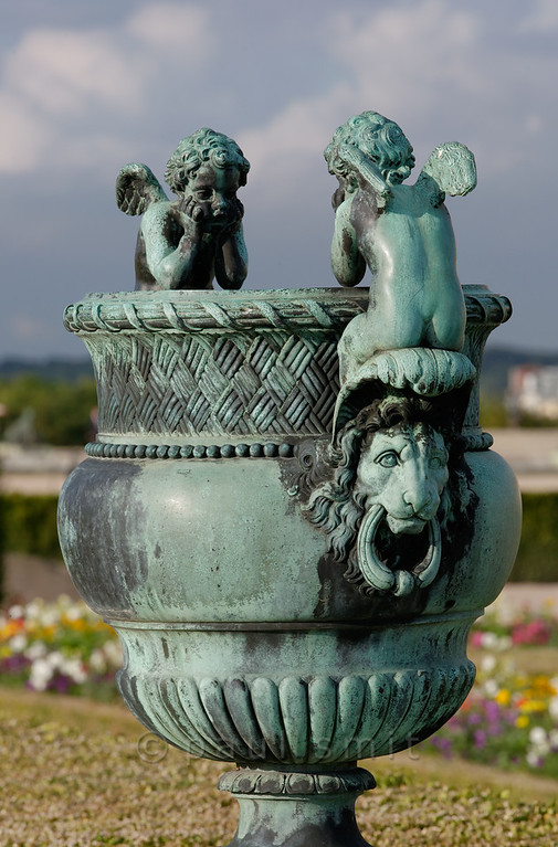 [FRANCE.ILEDEFRANCE 11108] 'Bronze vase with cupids, Parterre du Midi, Palace Gardens of Versailles.'  This vase is a copy by Calla, made in 1852, from an 17th century original by Claude Ballin that had been melted to be used in the war against the League of Augsburg, a way for the king to show that he himself made sacrifices as well as the people of France. You can find the vase at the Parterre du Midi, in front of the south wing of the Palace. Photo Paul Smit.