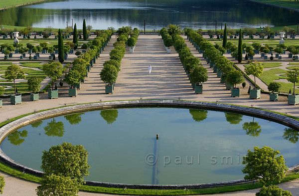 [FRANCE.ILEDEFRANCE 11066] 'Orangerie, Palace Gardens, Versailles.'  Overlooked by the Château, the Orangerie - with its wide space and pure lines and dating from 1686 - is one of the crowning achievements of architect Jules Hardouin-Mansart. The Orangerie Parterre covers no less than three hectares. In the reign of Louis XIV it was decorated with sculptures now kept in the Louvre museum. Consisting of six sections of lawn and a circular pool, in the summer it features 1,055 trees in wooden boxes, mostly orange trees, but palm trees, oleanders, pomegranate trees and eugenias as well. They spend the winter inside. Photo Paul Smit.