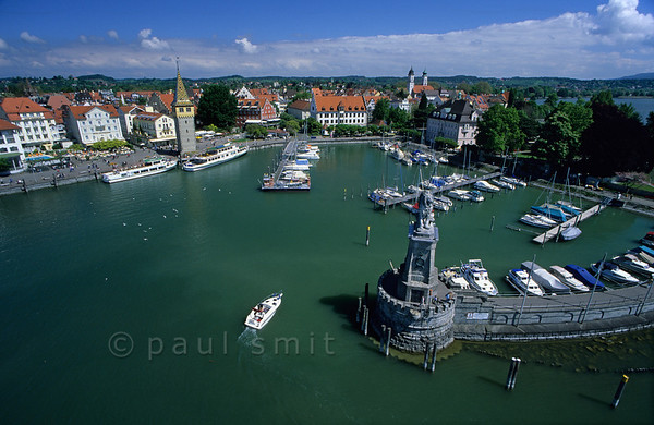 [GERMANY.BAYER 00679]  'Port of Lindau.'  Calling Lindau the 'Venice of Bavaria' is overstated, allthough indeed it's situated on an island. The other slogan fits better: 'The Happy End of Germany'. Waterside terraces overlook the port. Photo Paul Smit.
