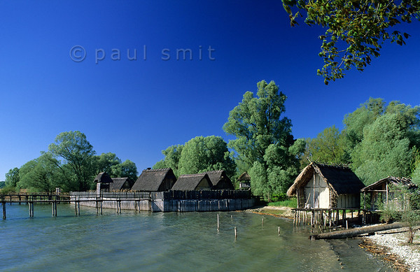 [GERMANY.BAWU 00720] 'Stone Age village.'  West African huts? Tahiti shore? Rather a German Stone Age lake-dwelling, reconstructed in the Pfahlbau open air museum in Unteruhldingen. Photo Paul Smit.