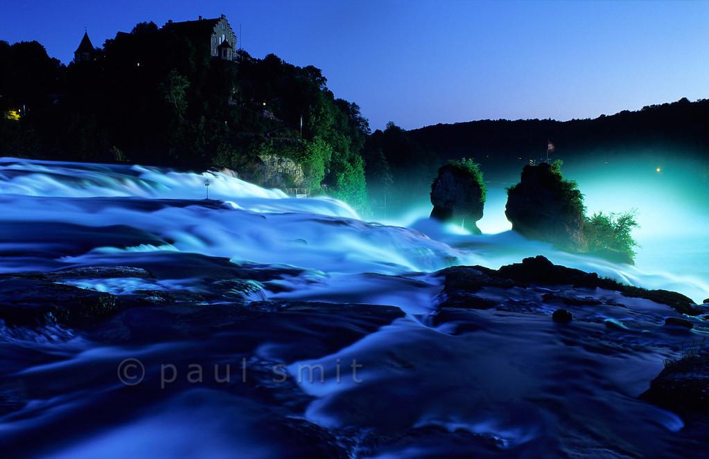 [SWITZER.MITTEL 00814] 'Rhine waterfall.'  Europe's largest waterfall, the Rheinfall near Schaffhausen in Switzerland, thunders down through the evening light. Photo Paul Smit.