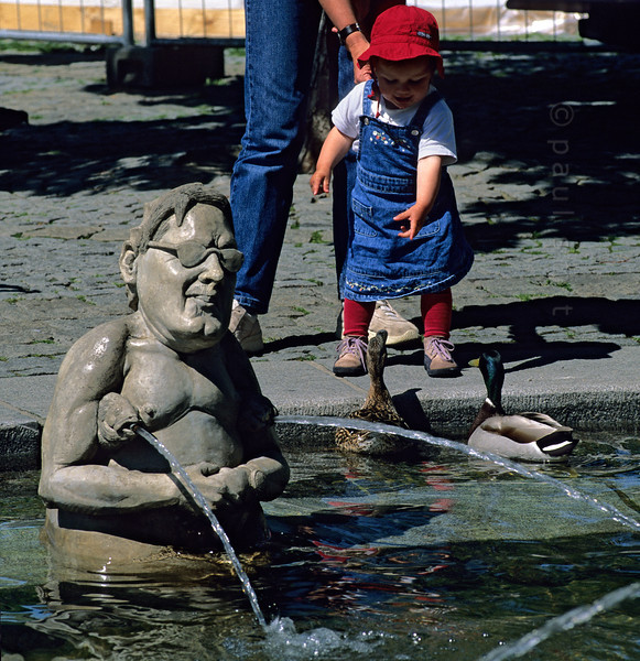 [GERMANY.BAWU 00740] 'Lenkbrunnen.'   Everybody seems to enjoy himself in and around the Lenkbrunnen, a fountain at the lakeside promenade of Überlingen. It's called after Peter Lenk, who sculpted it . Photo Paul Smit.