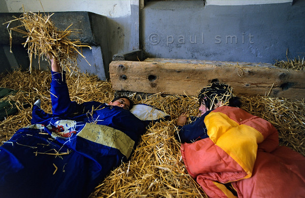 [SWITZER.MITTEL 00885]  'Sleeping in straw'  At many places, especially on the Swiss side of the Bodensee, you can spend the night in a straw 'bed' at a farm. Children like it a lot, especially the straw battles. It even seems to be healthy. Photo made at the Strohhotel of farm family Stäheli, Kratzern 39, 9320 Frasnacht. Photo Paul Smit.