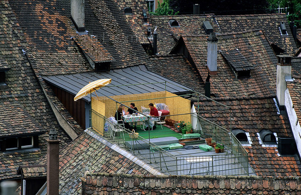 [SWITZER.MITTEL 00833]  'Schaffhausen roofs.'  From the Munot fortress in the heart of Schaffhausen you are looking over the rooftops of the city. And closer to heaven life is more enjoyable, the people in the roof garden seem to think. Photo Paul Smit.