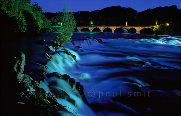 [SWITZER.MITTEL 00821] 'Rhine waterfall.'  Europe's largest waterfall, the Rheinfall near Schaffhausen in Switzerland, thunders down through the evening light. Photo Paul Smit.