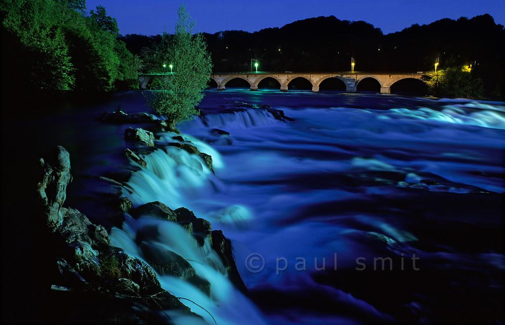 [SWITZER.MITTEL 00821] 'Rhine waterfall.'  Europe's largest waterfall, the Rheinfall near Schaffhausen in Switzerland, thunders down through the evening light. Photo Paul Smit.