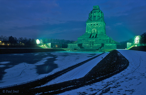 [GERMANY.SACHSEN 38]  'Völkerschlachtdenkmal near Leipzig.'  Everything looks heavy, the atmosphere is dark and the interior seems to be imported straight from the computer game Doom: the Völkerschlachtdenkmal. It seems as if the granite giants inside can wake up from their slumber any moment and crush you under their weight. It was built in 1913 as a monument for peace and commemorates the tens of thousands of deceased soldiers that fell one hundred years earlier in an enormous battle against Napoleon.  In reality nothing refers to peace, and everything to megalomanic, brainless Teutonhood. Maybe not so strange, being constructed only one year before the First World War. It shows clearly with which philosophy the country would thrust itself into war. Its Wagnerian, mythical Germanian kitsch makes clear that Germany was in fact ready for Nazism in 1913, ten years before its actual conception. Photo Paul Smit.